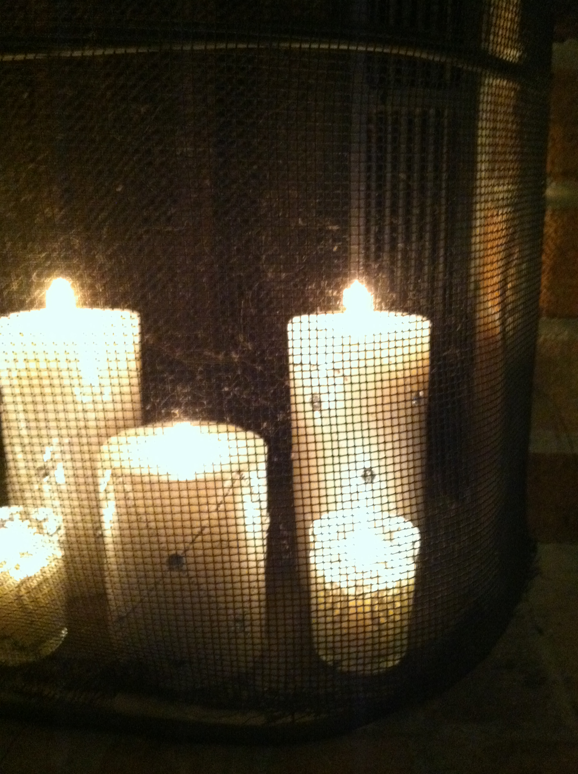 a little sparkle adding candles to the fireplace happily ever